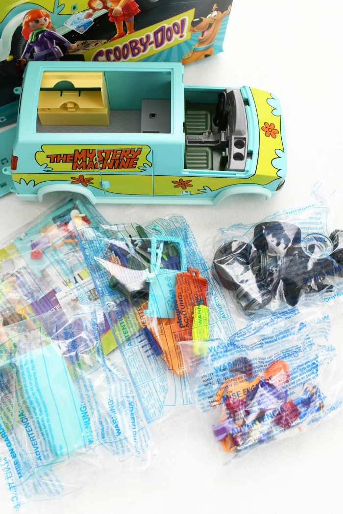 The mystery machine Playmobil toys in plastic packaging.