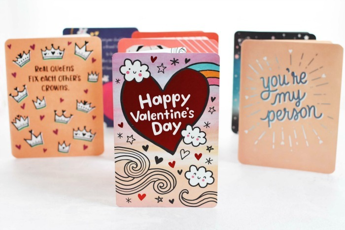 Valentines Day American Greetings Cards on white table standing up.