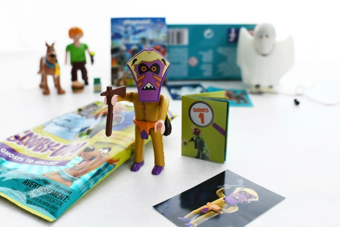 Witch Doctor mystery pack displayed with other Scooby toys on a white table.