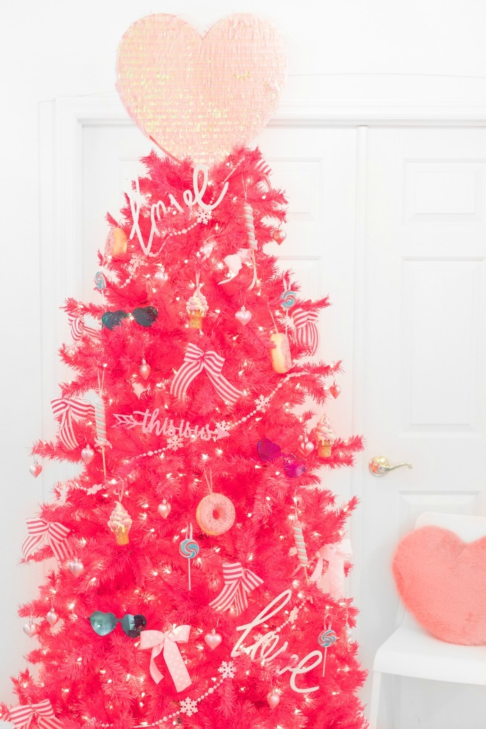 Hot pink Valentines day tree with pink and blue decor.