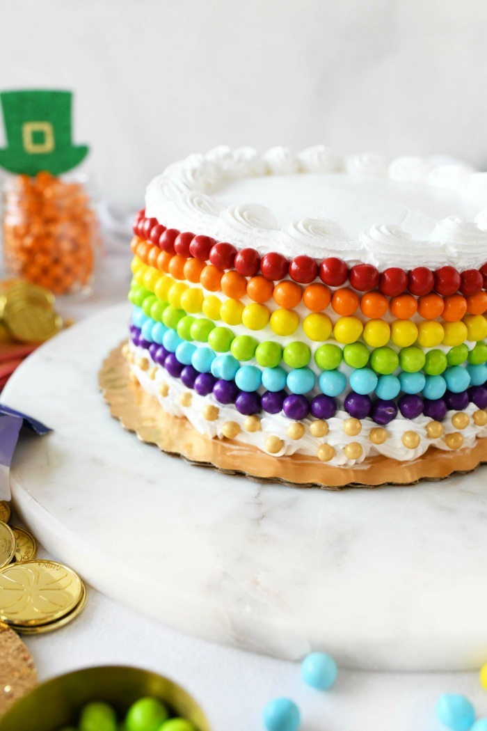 White cake decorated with rainbow candies.
