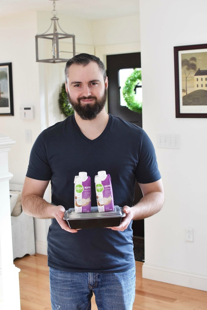 Jared with Zone Keto products in living room.