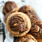 Nutella Swirl Banana Muffins in parchment-lined loaf pan