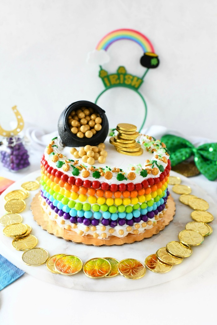 Rainbow Cake decorated with rainbow and gold candy Sixlets.