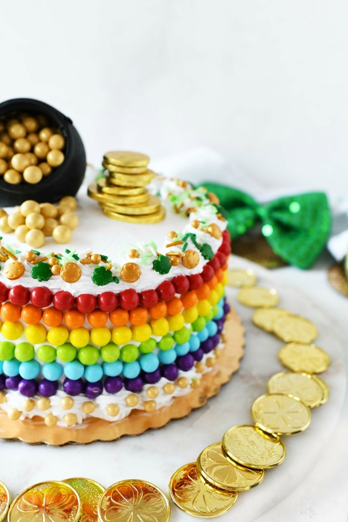 Rainbow cake side view with colorful candies.