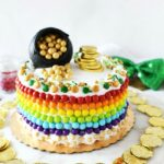 St Patricks Cake with gold coins, candy Sixlets, and sprinkles.