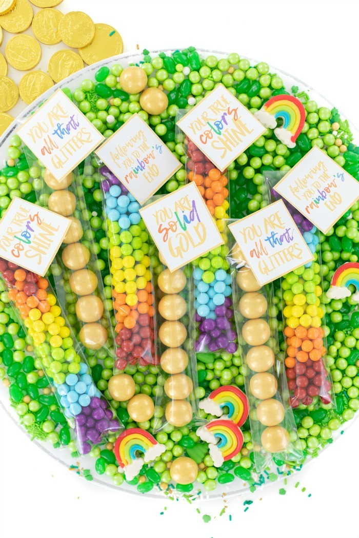 St. Patrick's Day candy tubes on tray with green candies.