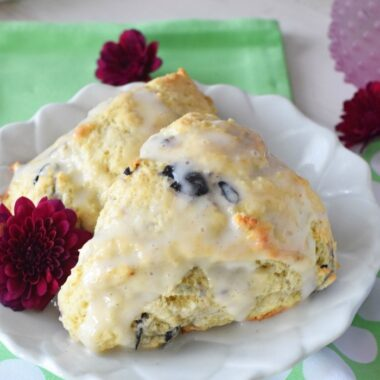 Blueberry Vanilla Scones on a small white plate with a green dot napkin.