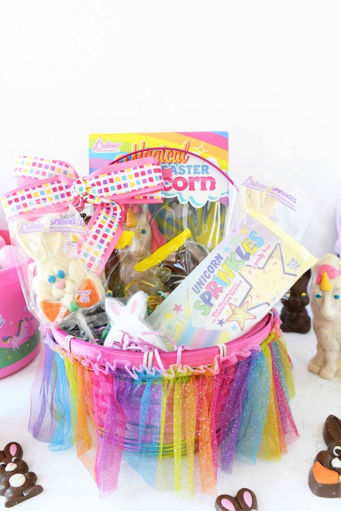 Colorful pink Easter basket with unicorn candy.