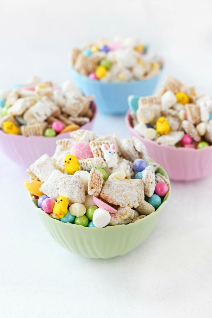 Easter Bunny Bait in pastel dishes on a white table.