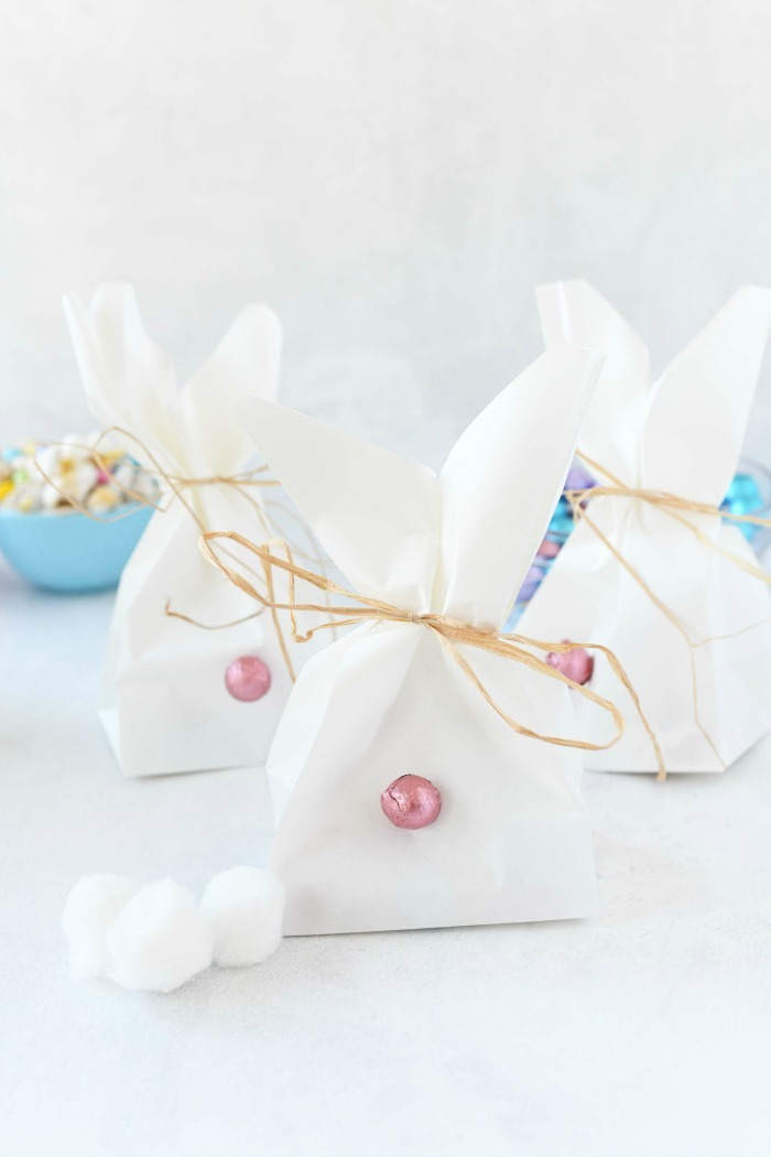 Easter Bunny goodie bags on white table.