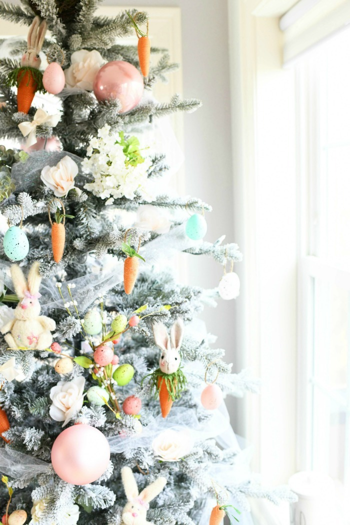 Close up of Easter Christmas Tree decorated with flowers and bunnies.
