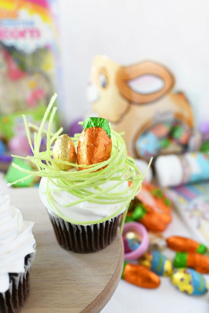 Easter Egg in Grass Cupcake on wooden tray.
