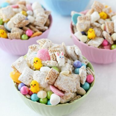 Easter Snack Mix in small, colorful pastel bowls.