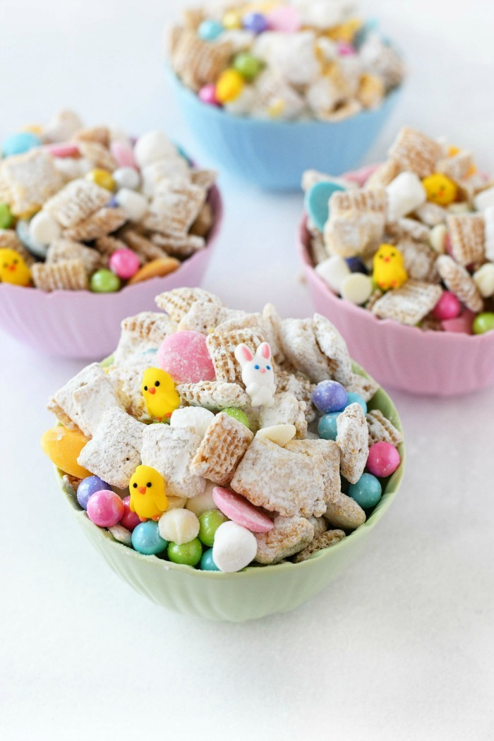 Easter Snack Mix in pastel dishes on white table.