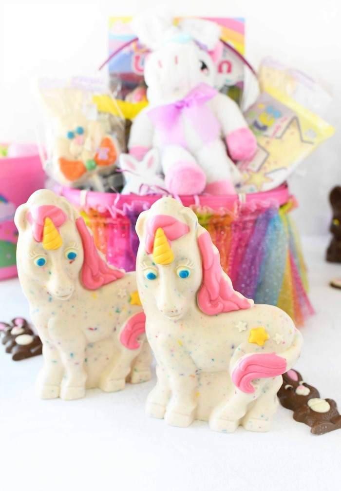 Easter Unicorn candies with unicorn basket in the background.