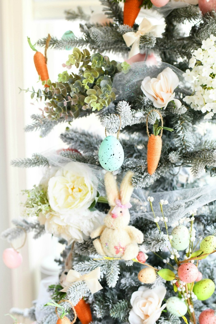 Farmhouse Easter Tree decor close up. Tree is decorated with Easter bunnies, eggs, and flowers.