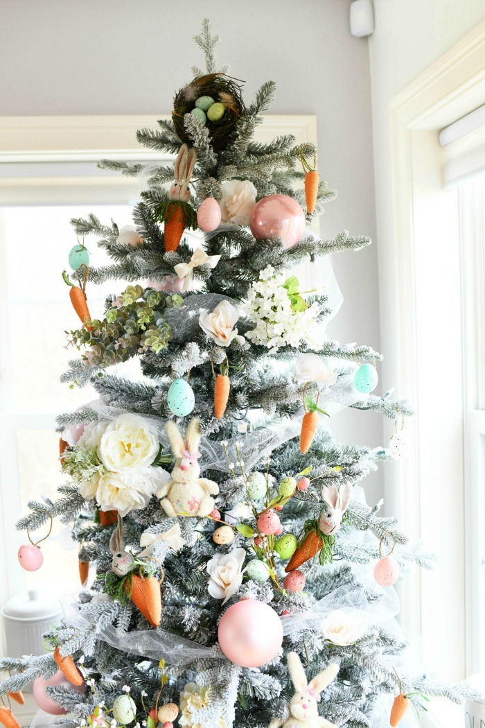 Farmhouse Spring Tree with Easter flowers, bunnies, eggs, and carrot ornaments.