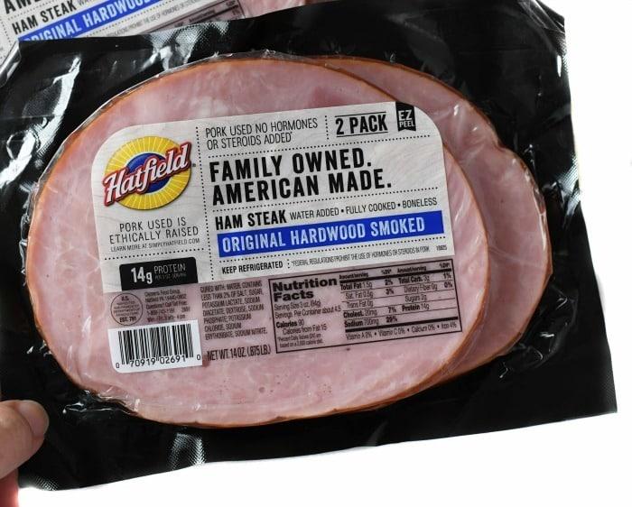 Hatfield ham steaks in-hand with a white background.