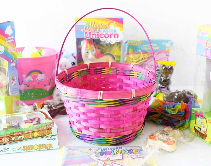 Pink Easter basket with Easter candies around it.