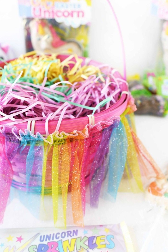Rainbow Easter basket filled with colorful Easter grass.