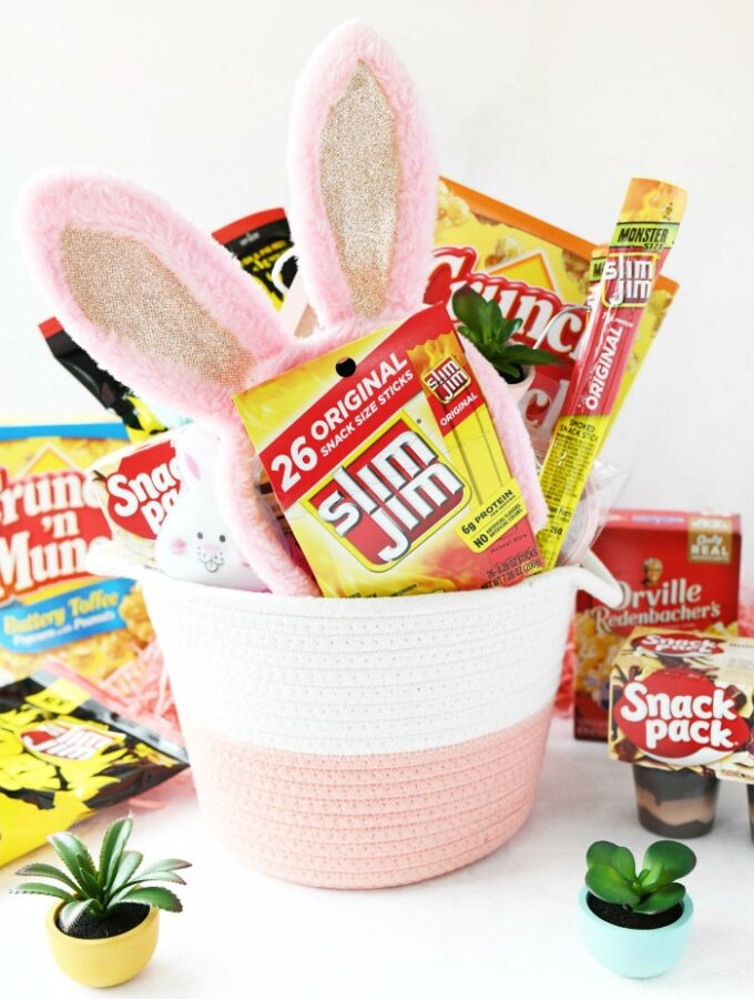 Girl's pink easter basket with snacks and pink bunny ears