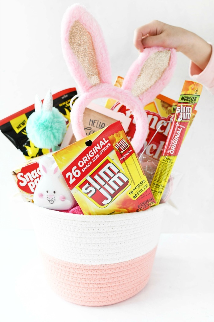 Girl's pink Easter basket loaded with shelf stable snacks