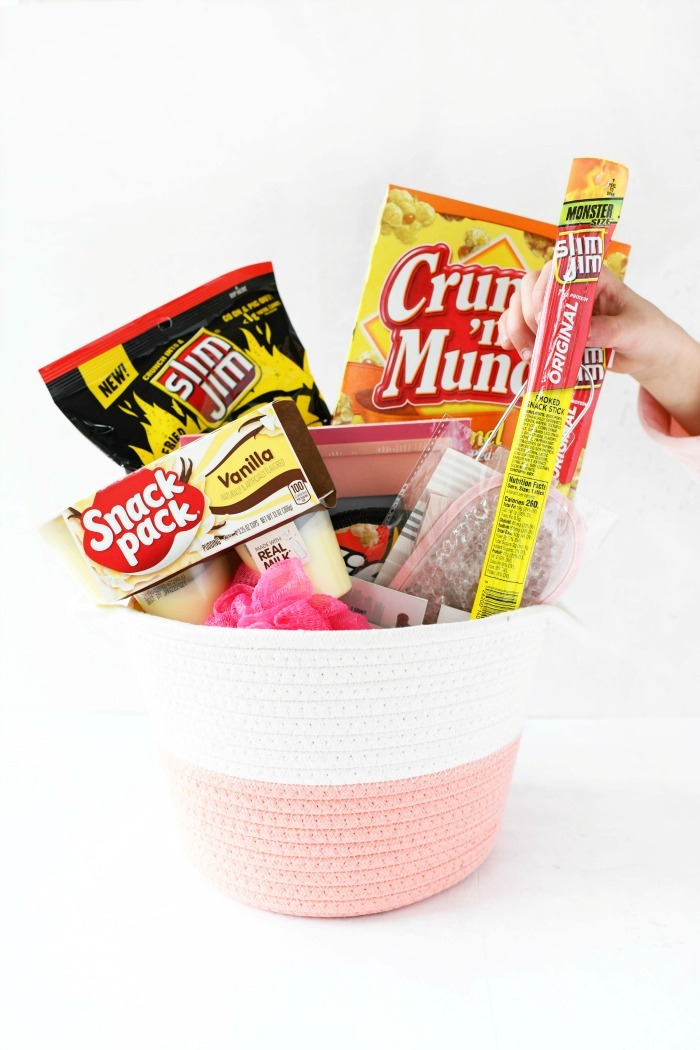 Pink Easter Basket with Slim Jim and other pantry snacks inside.