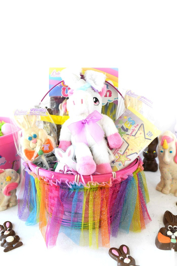 Unicorn Easter Basket with lots of candies inside.