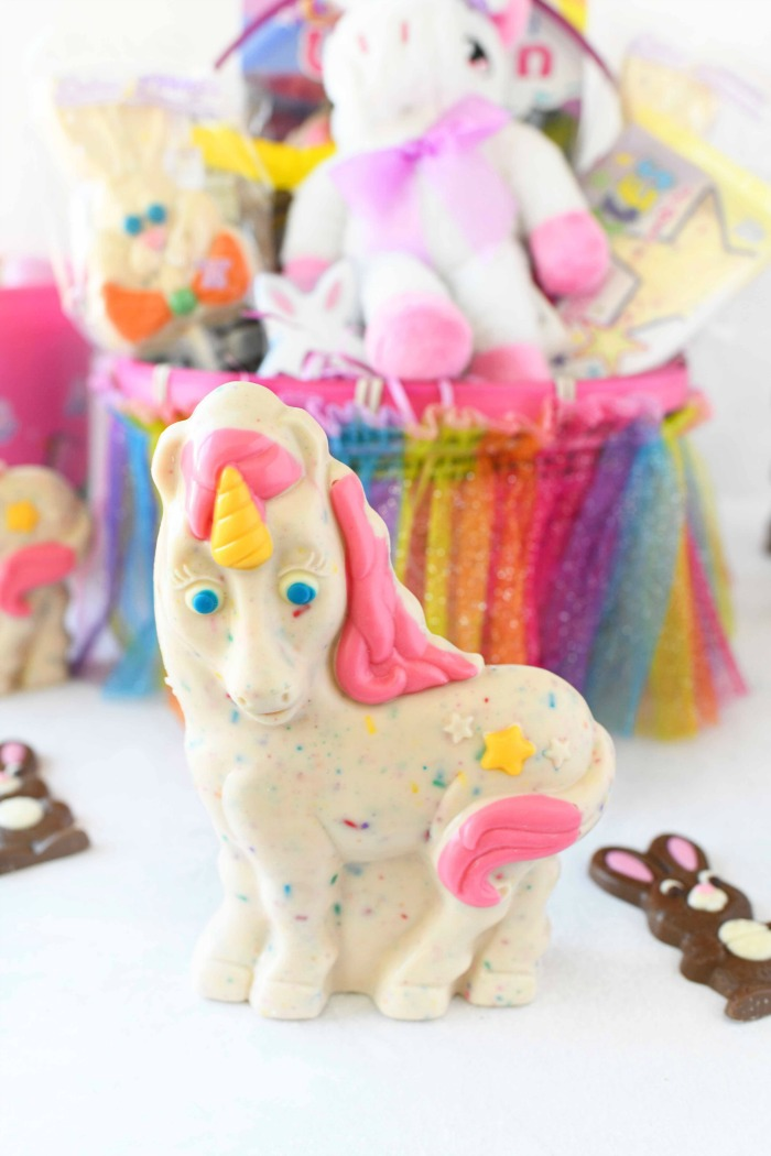 Unicorn Easter Candy with Easter basket in the background.