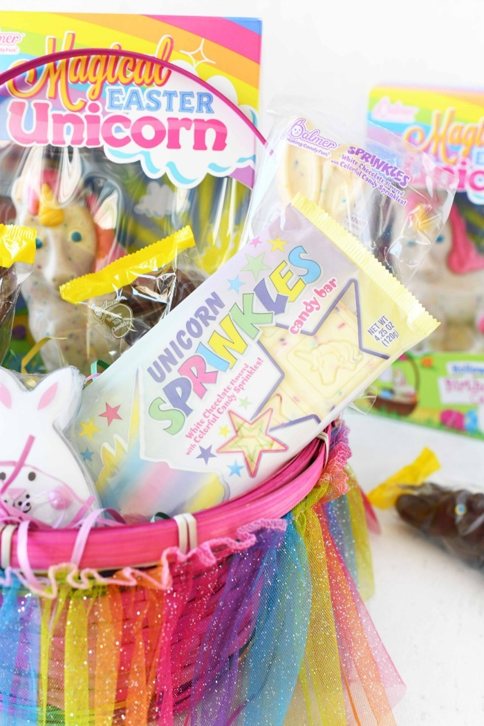 Unicorn sprinkles candy bar in Easter basket.