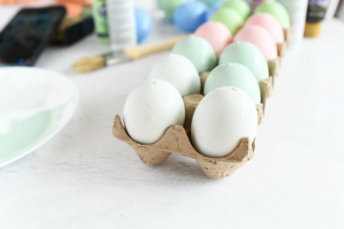 One dozen of painted farmhouse eggs in paper dozen.