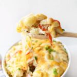 Crab Meat Casserole on a wooden spoon