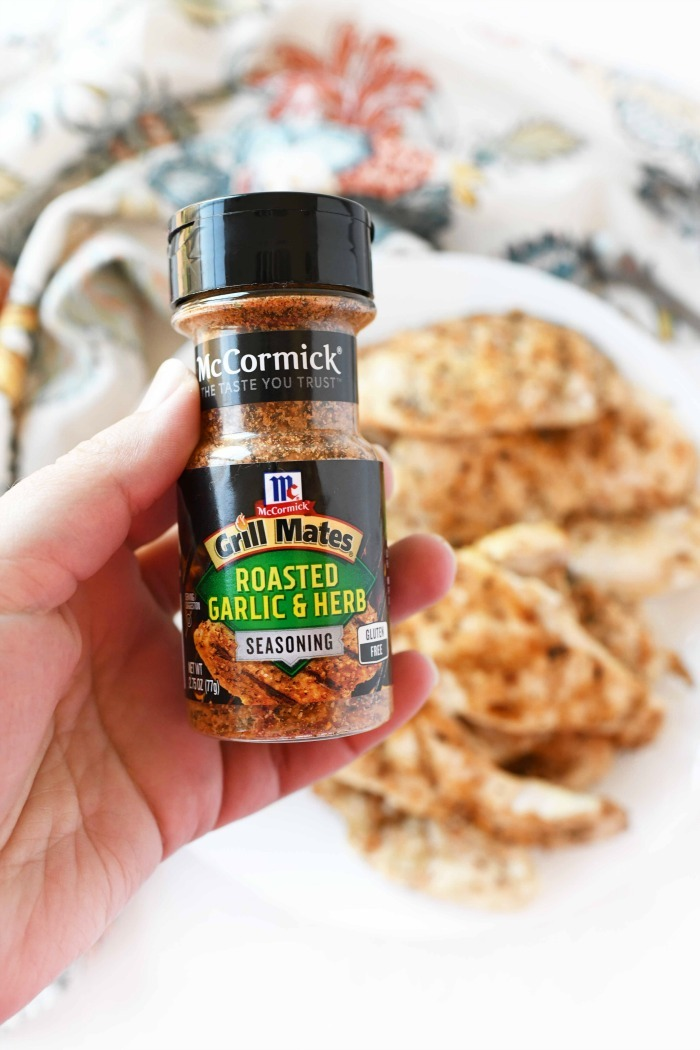 McCormick Grill Mates Roasted Garlic & Herb in someone's hand.