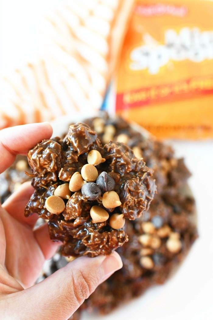 Frosted Mini Spooners No-Bake cookies in a hand.