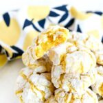 Lemon Cake Mix cookies on white dish with lemon napkin