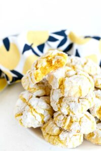 Lemon Cake Mix cookies on white dish with lemon napkin