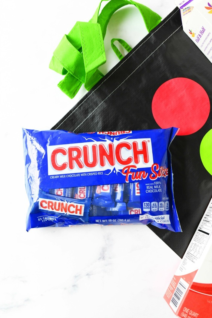 Nestle Crunch bars near a Stop & Shop bag.