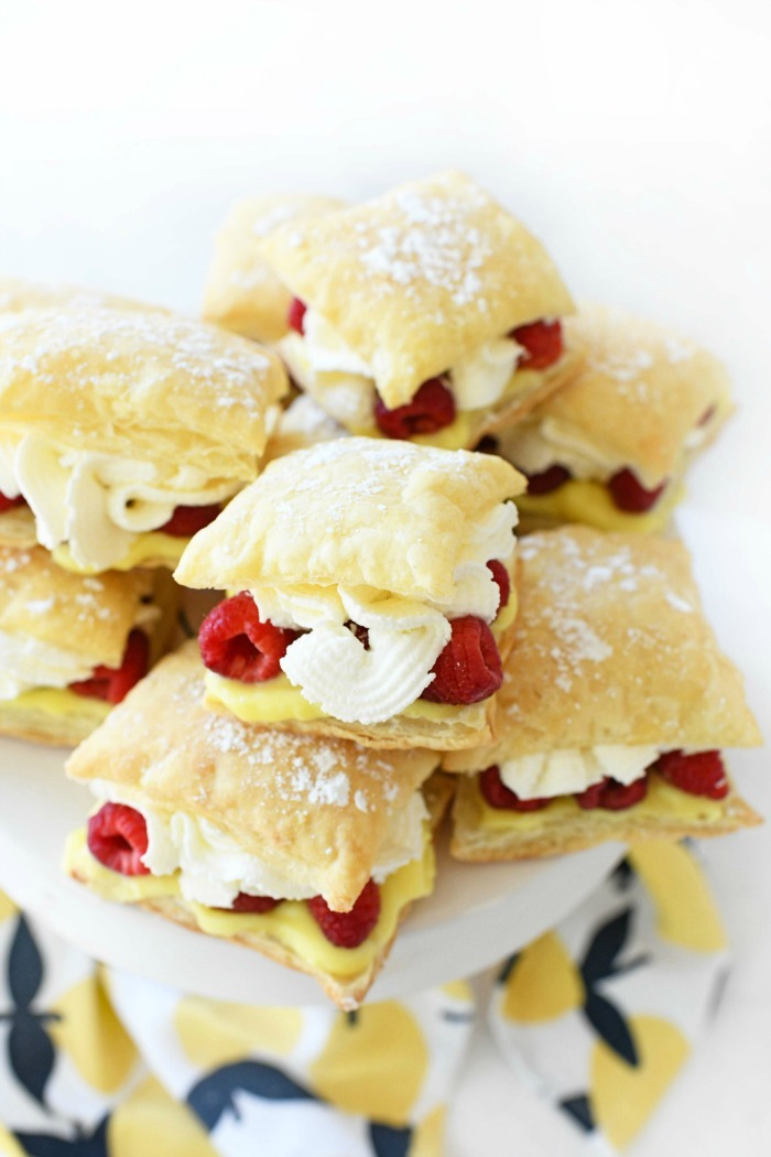 Lemon Raspberry Napoleons on a tray with lemon napkin.