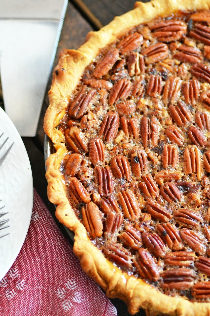 Pecan Pie half up close on wooden table.