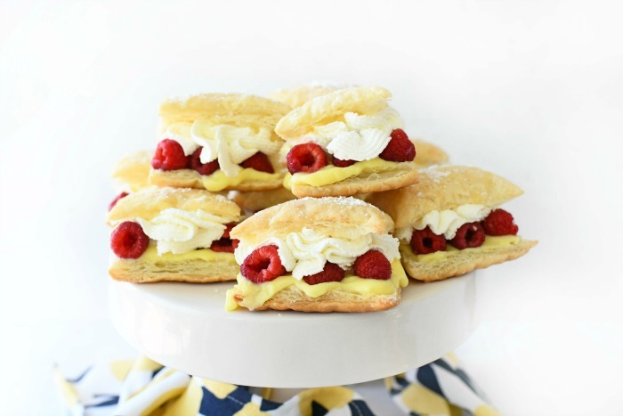Raspberry Lemon Squares on white stand.