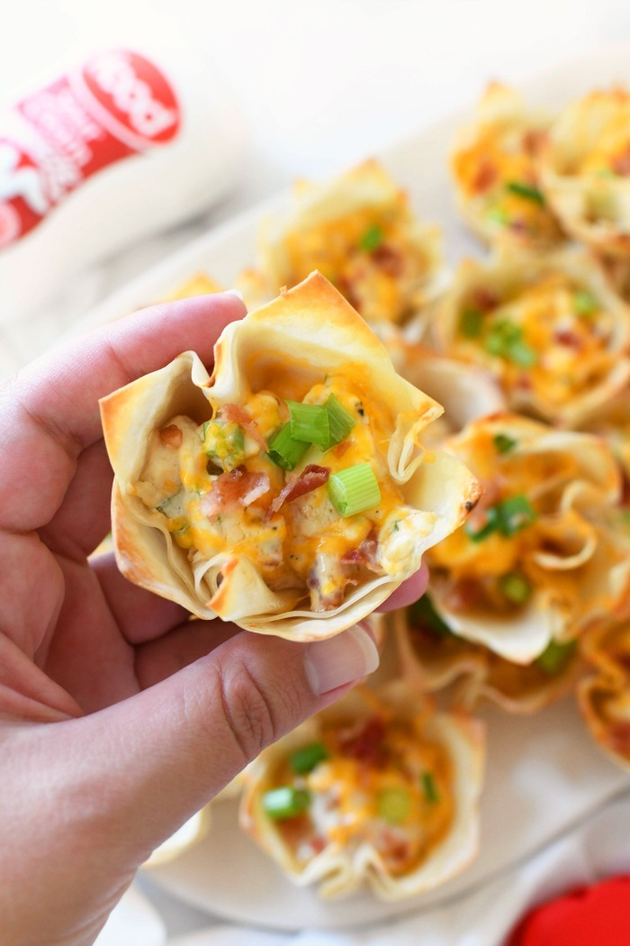 Bacon & Cheese Wontons in hand.