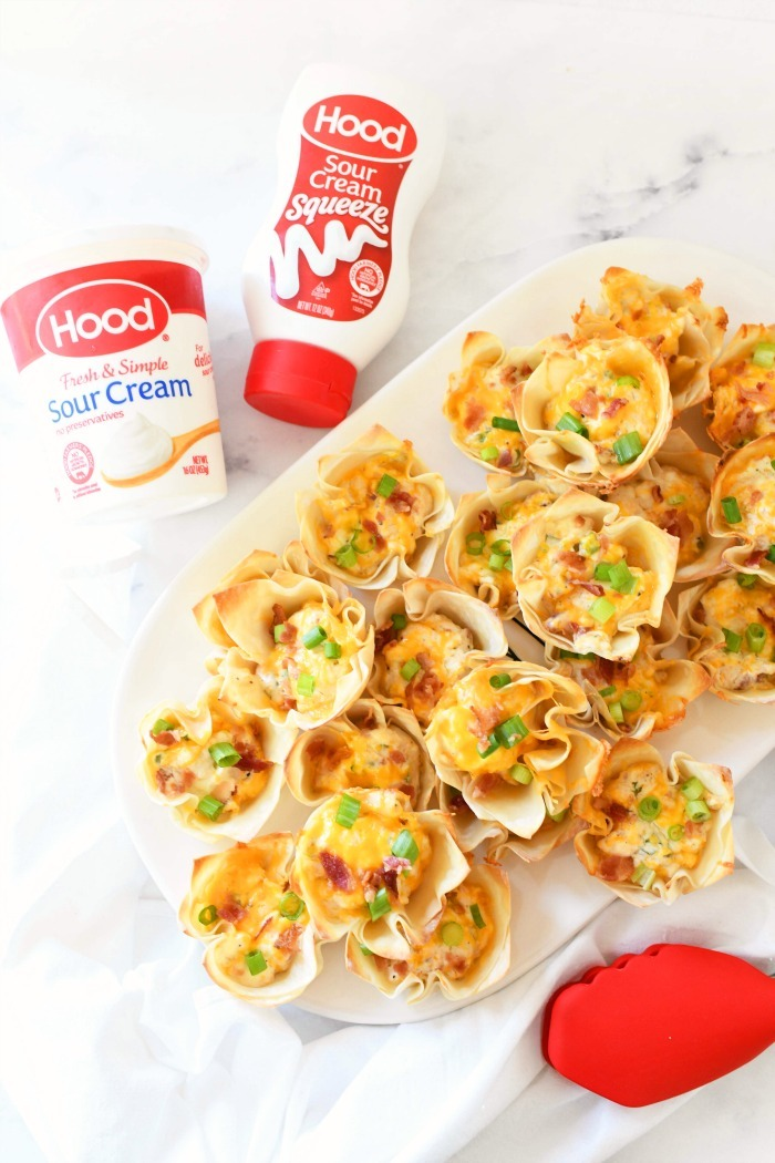 Bacon & Cream Cheese Wontons on platter with sour cream.