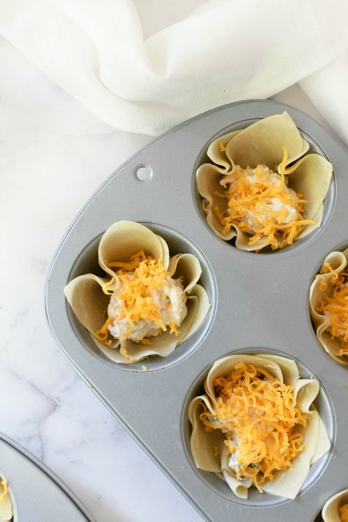 Bacon & cheese cups prebaked in a muffin tin.