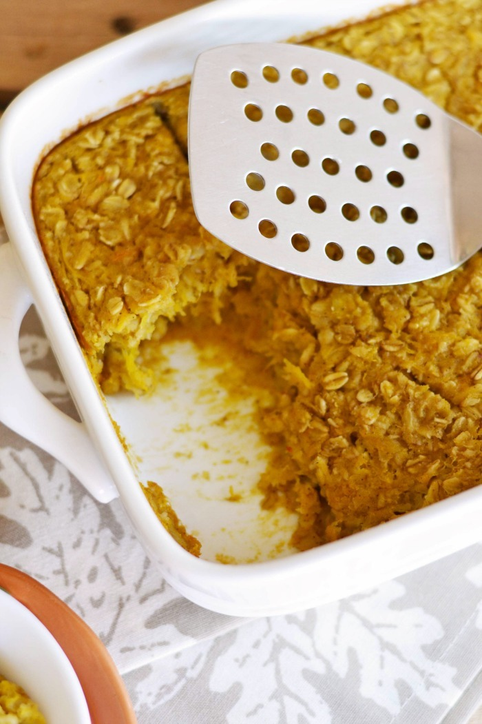 Baked Pumpkin Oatmeal with a spatula.