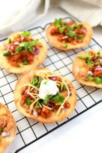 Baked Tostadas on a wire rack.