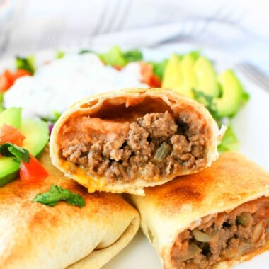 Beef Chimichangas opened up on white plate.