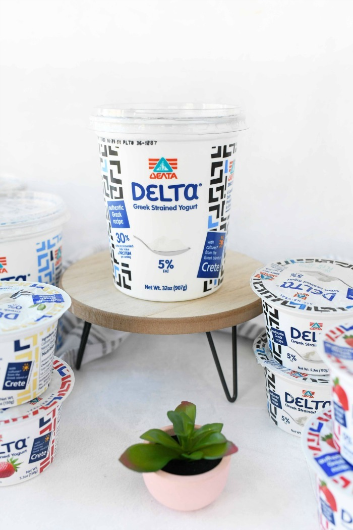 Delta Greek strained yogurt on stand with a white background.