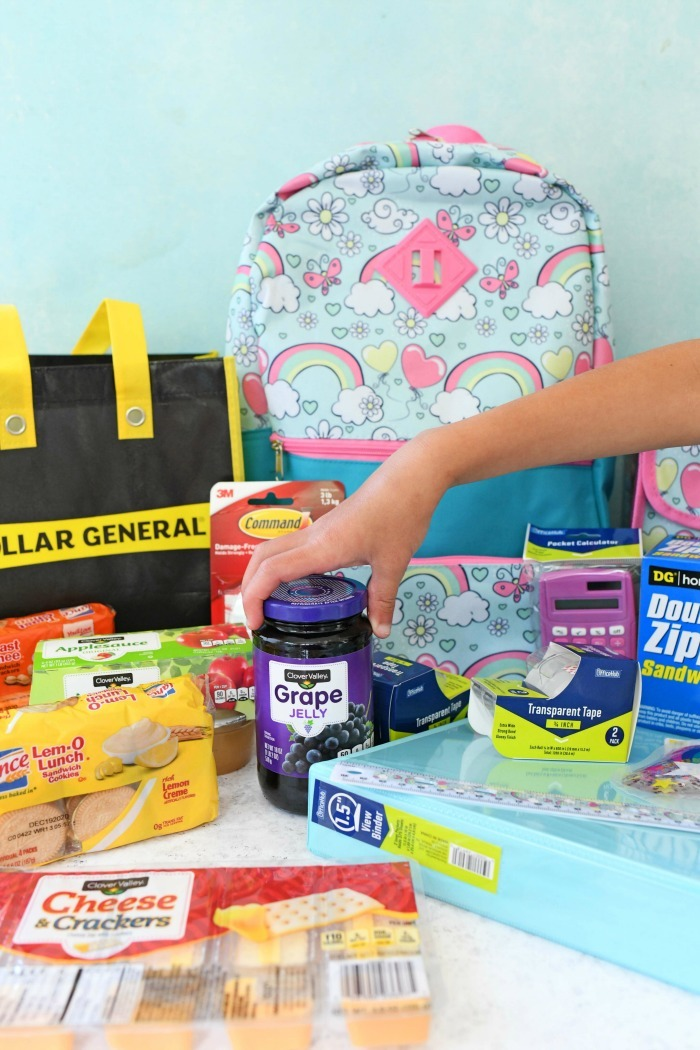 Dollar General Back to School supplies on blue and white table.