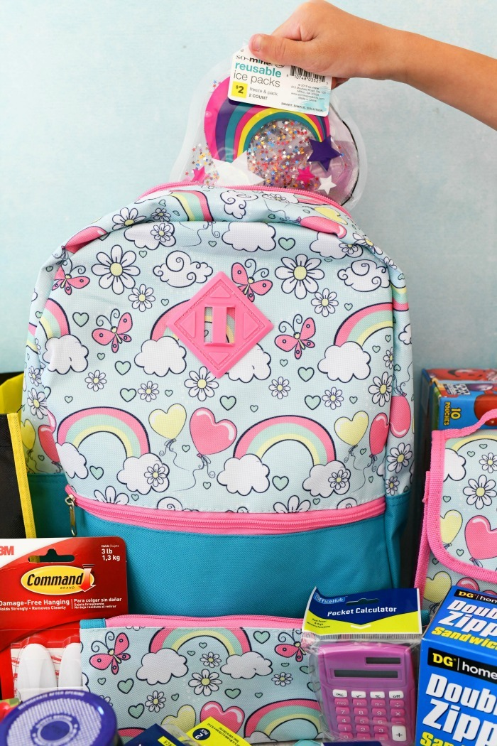 Dollar general school supplies in a blue back pack.